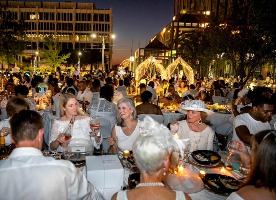 <strong>Civic Center Plaza in Downtown Memphis was transformed into an open-air dining area Saturday evening for the second annual Diner En Blanc. The hundreds who attended did not know ahead of time where in the city they would be dining. They were transported to their destination by chartered buses.</strong> (Mike Kerr/Special to Daily Memphian)