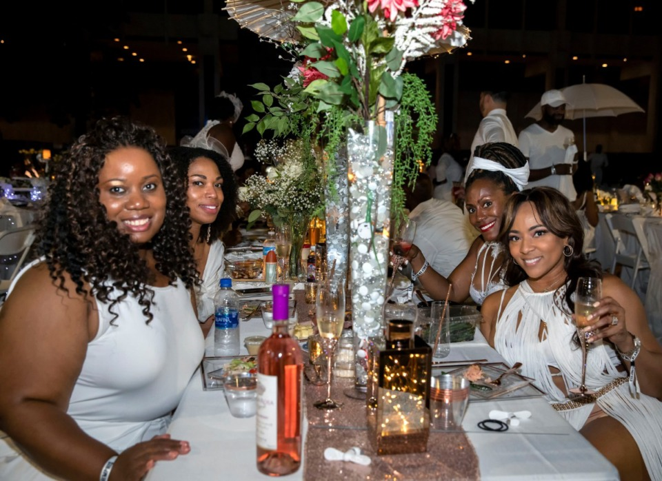 <strong>Posing for a selfie Saturday night at Diner en Blanc were (from left) Karla Hollingshed, Tierney Armour, Laschunn Dickerson and Sabrina Tiller-Gladney. The four were among hundreds attending the outdoor dining event on Civic Center Plaza.</strong> (Mike Kerr/Special to Daily Memphian)