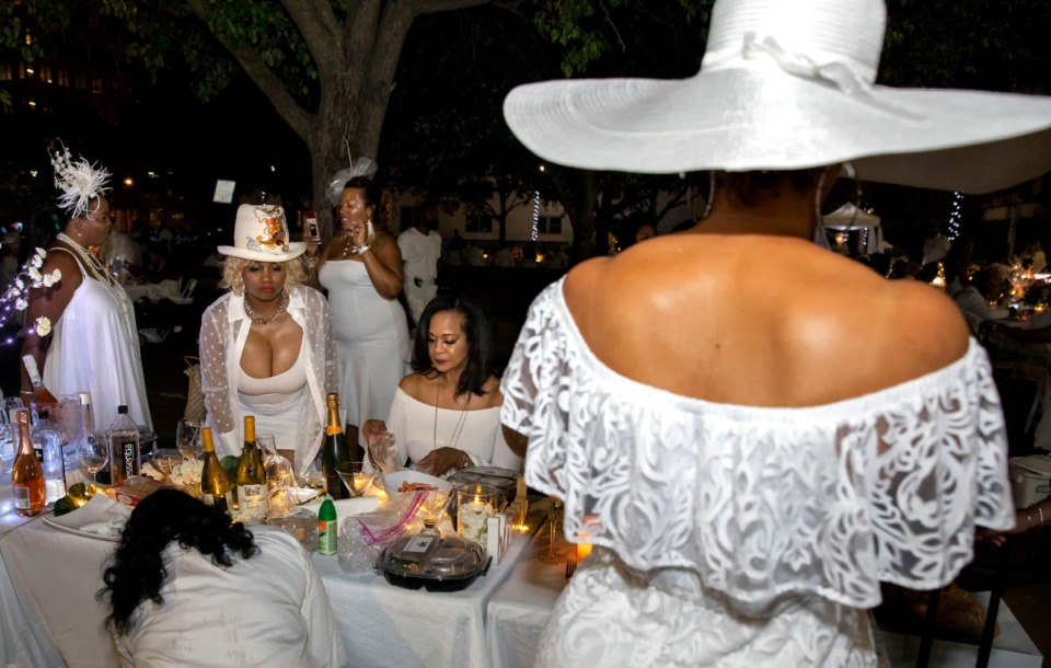 <strong>Fashion in the air as Civic Center Plaza in Downtown Memphis is transformed into an open-air dining area Saturday evening for the second annual Diner en Blanc. The hundreds who attended were required to dress all in white.</strong> (Mike Kerr/Special to The Daily Memphian)