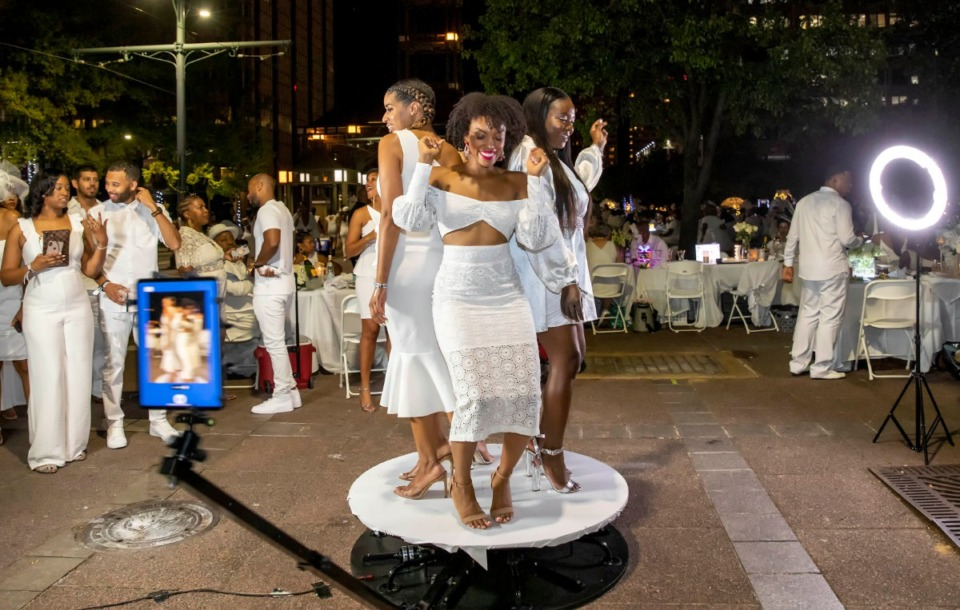 <strong>A digital tablet whirls quickly around a tilting, twisting platform to record the moment as three women perform for the moving camera at Civic Center Plaza.</strong> (Mike Kerr/Special to Daily Memphian)