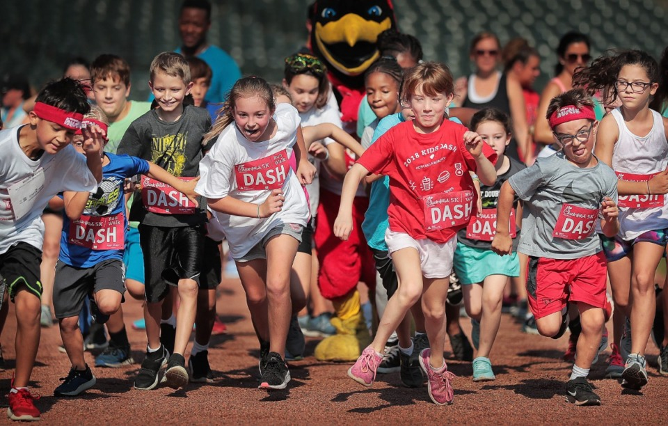 <strong>It's a dog-eat-dog start as young runners take off during the Kids Dash at AutoZone Park part of the activities planned around the 17th Annual Chick-fil-A 5K benefiting Junior Achievement on September 2, 2019.</strong> (Jim Weber/Daily Memphian)