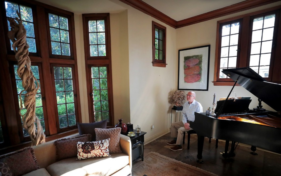 <strong>Though he spends most of his time in the open kitchen and living room off the garden, Rick Bartl's favorite room is where he keeps his piano. Bartl's house is one of the places on display during the 43rd Annual Central Gardens Home Tour taking place Sunday, Sept. 8.</strong> (Jim Weber/Daily Memphian)