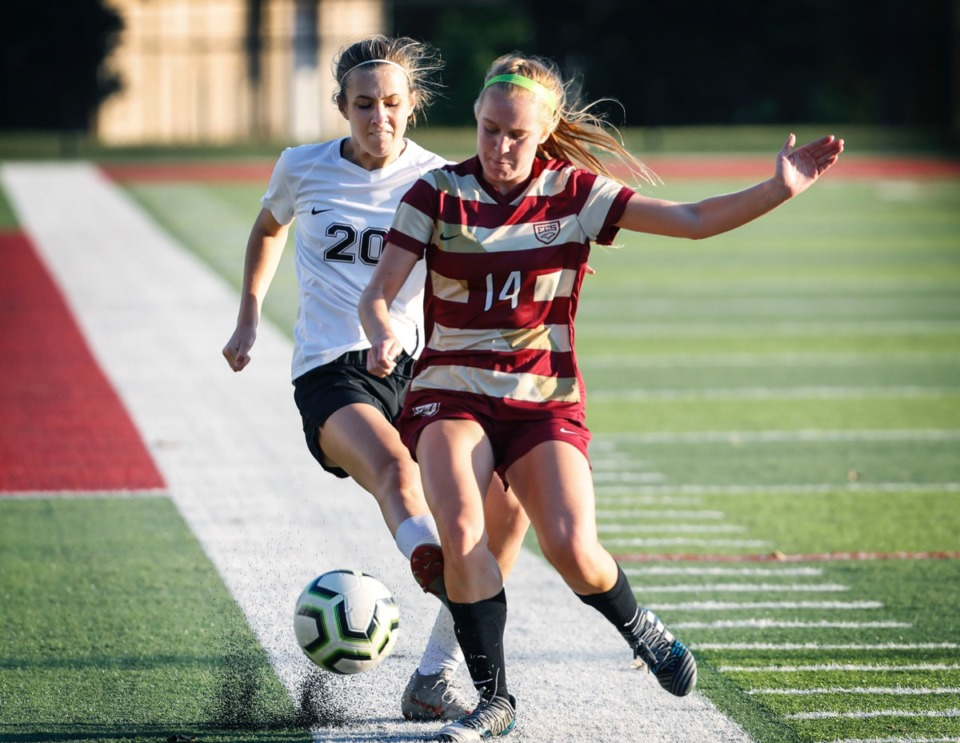 <strong>Houston defender Miller Garner (left) battles ECS midfielder Anna Leigh Coleman (right) for a loose ball Thursday, Sept. 5.</strong> (Mark Weber/Daily Memphian)