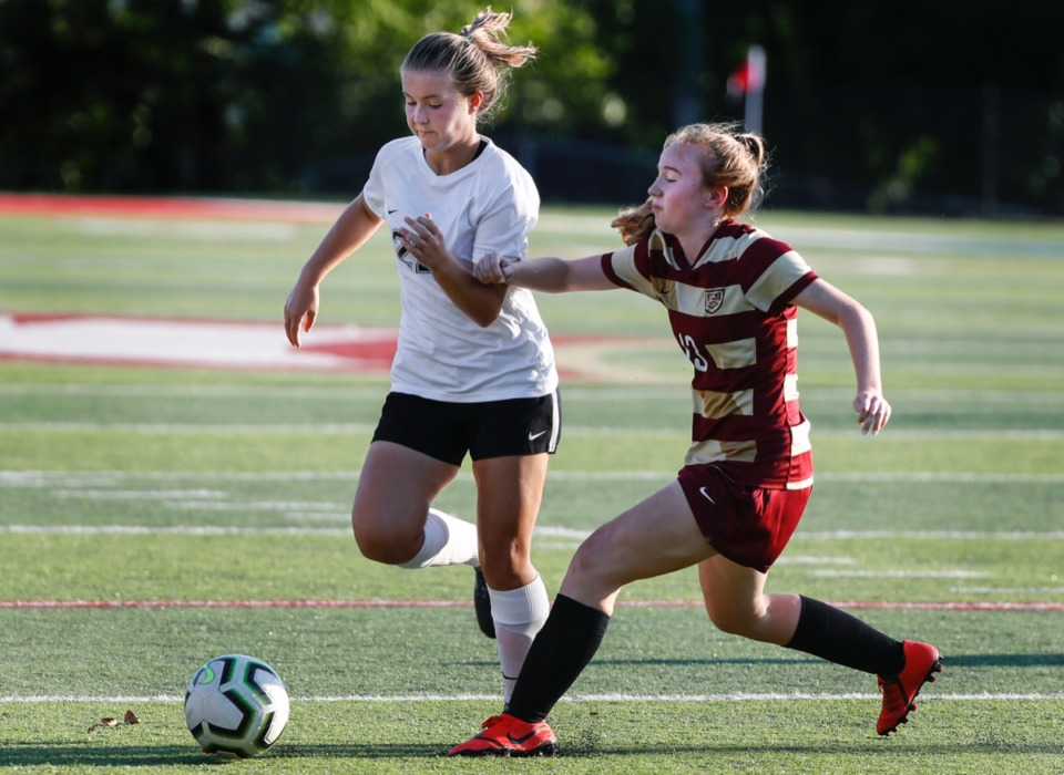 <strong>Houston midfielder Gertie Langford (left) dribbles around ECS defender Anna Grace King (right) Thursday, Sept. 5.</strong> (Mark Weber/Daily Memphian)