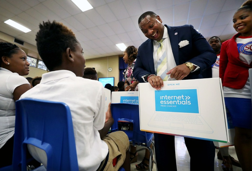 """<strong>Shelby County Schools Superintendent Joris Ray surprises Cummings K-8 School students with a free laptop Friday, Aug. 6, 2019, as a part of Comcast's Digital Inclusion Day in Memphis, a program that aims to help low-income families bridge a """"digital divide.""""</strong> (Patrick Lantrip/Daily Memphian)"""
