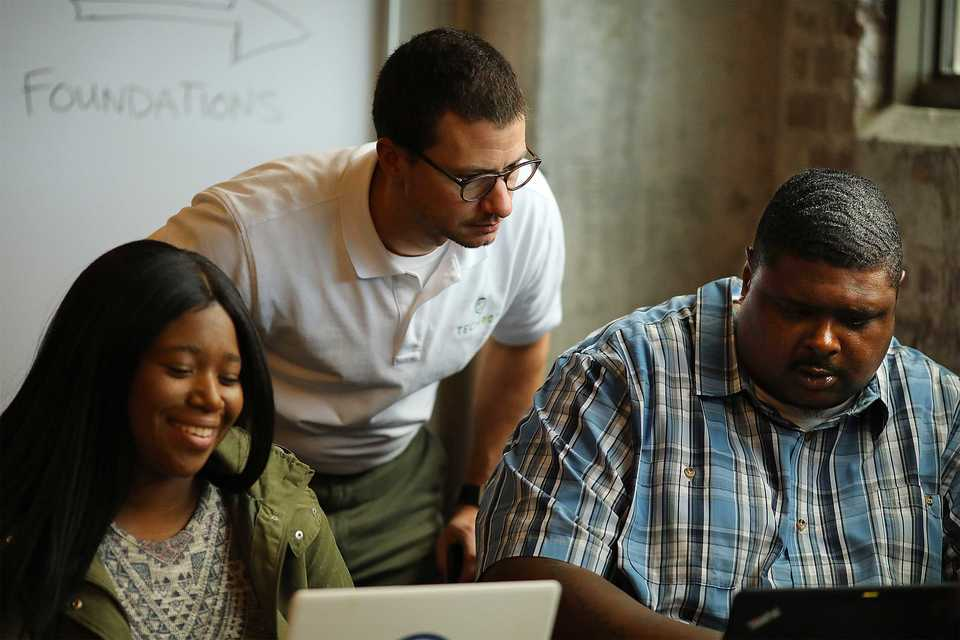 <strong>Blair Perry of Tech901 instructs his students during an Oct. 18, 2018, IT Foundations course at the organization&rsquo;s Crosstown Concourse campus. Tech901 was one of six local non-profits to recently receive a Community Foundation grant.</strong> (Patrick Lantrip/Daily Memphian)