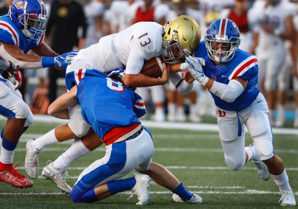 <strong>CBHS quarterback Trace Heffernan (middle) is tackled by MUS defenders Collins Robinson (middle bottom) and Charlie Street (right) Friday, Sept. 5.</strong> (Mark Weber/Daily Memphian)