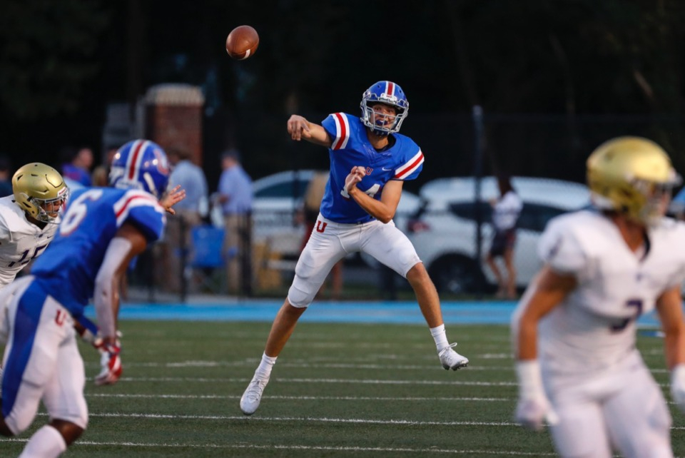 <strong>MUS quarterback Vaught Benge (center) passes against the CBHS defense at MUS Friday, Sept. 6, 2019.</strong>&nbsp;<strong>The Owls won, 37-24.</strong> (Mark Weber/Daily Memphian)