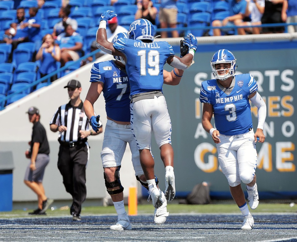 <strong>University of Memphis quarterback Brady White (3) rushes to congratulate teammate Kenneth Gainwell (19) after the latter scored a touchdown during a 55-24 victory of Southern University on Saturday, Sept. 7, 2019, at Liberty Bowl Memorial Stadium.</strong>&nbsp;(Patrick Lantrip/Daily Memphian)