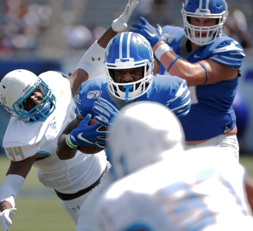 <strong>University of Memphis running back Rodrigues Clark (25) barrels through the Southern University defense after a blowout win at Liberty Bowl Memorial Stadium on Saturday, Sept. 7, 2019.</strong> (Patrick Lantrip/Daily Memphian)