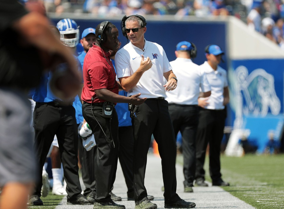 <strong>University of Memphis head coach Mike Norvell talks with an assistant during the second half of the Tigers' 55-24 victory over Southern University&nbsp;at Liberty Bowl Memorial Stadium on Saturday, Sept. 7, 2019. &nbsp;</strong>(Patrick Lantrip/Daily Memphian)
