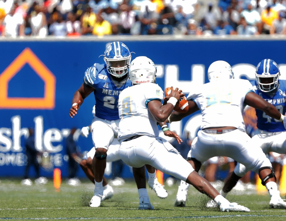 <strong>University of Memphis linebacker JJ Russell chases down Southern University quarterback Ladarius Skelton (8) during a 55-24 home victory of Southern University&nbsp;at Liberty Bowl Memorial Stadium on Saturday, Sept. 7, 2019. </strong> (Patrick Lantrip/Daily Memphian)
