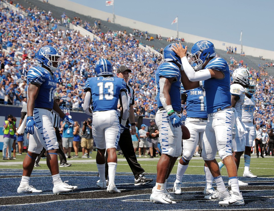 <strong>University of Memphis quarterback Brady White (3) celebrates with teammates after a touchdown during the Tigers' 55-24 victory over Southern University at Liberty Bowl Memorial Stadium on Saturday, Sept. 7, 2019.</strong> (Patrick Lantrip/Daily Memphian)