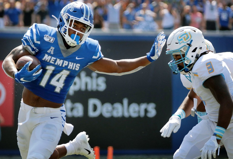 <strong>University of Memphis wide receiver Antonio Gibson (14) stiff-arms Southern University cornerback Elijah Small (3) on his way to a first half touchdown at the Liberty Bowl Memorial Stadium on Saturday, Sept. 7, 2019.</strong> (Patrick Lantrip/Daily Memphian)