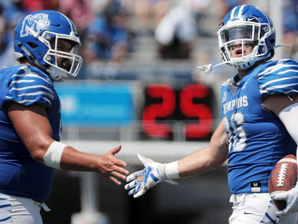 <strong>University of Memphis tight end Joey Magnifico (86) high fives a teammate after a long run in the third quarter of a 55-24 victory of Southern University Saturday, Sept. 7, 2019.</strong> (Patrick Lantrip/Daily Memphian)
