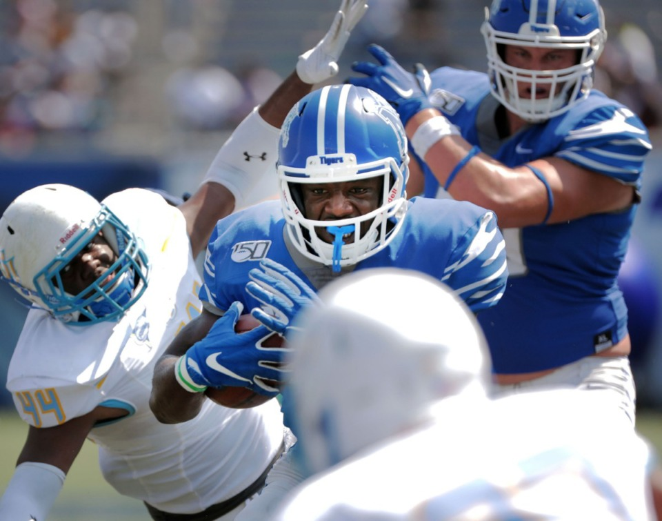 <strong>University of Memphis running back Rodrigues Clark (25) barrels through the Southern University defense during&nbsp; the Tigers' 55-24 win&nbsp;at Liberty Bowl Memorial Stadium on Saturday, Sept. 7, 2019.</strong> (Patrick Lantrip/Daily Memphian)