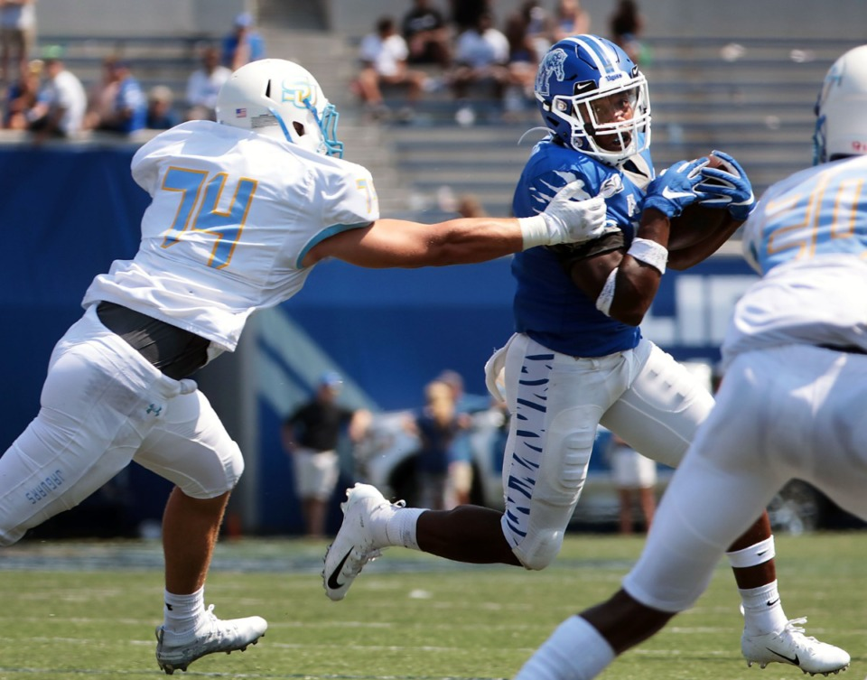 <strong>University of Memphis running back Timothy Taylor (21) dodges a Southern University defender during the fourth quarter of the Tigers' 55-24 victory over Southern University&nbsp;at Liberty Bowl Memorial Stadium on Saturday, Sept. 7, 2019.</strong> (Patrick Lantrip/Daily Memphian)