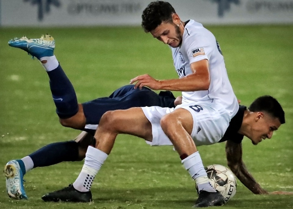 <strong>Memphis midfielder Pierre Da Silva collides with the Rangers' Ayyoub Allach during 901FC's 4-2 win over Swope Park at AutoZone Park on Sept. 7, 2019.</strong> (Jim Weber/Daily Memphian)