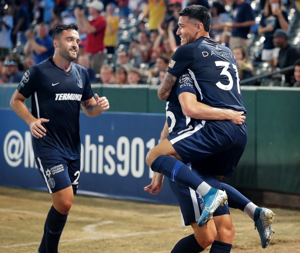 <strong>Memphis midfielder Pierre Da Silva (right) celebrates with collides with Josh Morton after a score during 901 FC's 4-2 win over Swope Park at AutoZone Park on Sept. 7, 2019.</strong> (Jim Weber/Daily Memphian)