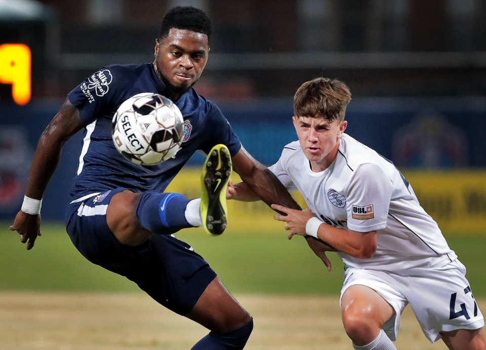 <strong>Memphis midfielder Marcus Epps keeps control under pressure by the Rangers' Tucker Lepley during 901 FC's 4-2 win over Swope Park at AutoZone Park on Sept. 7, 2019.</strong> (Jim Weber/Daily Memphian)