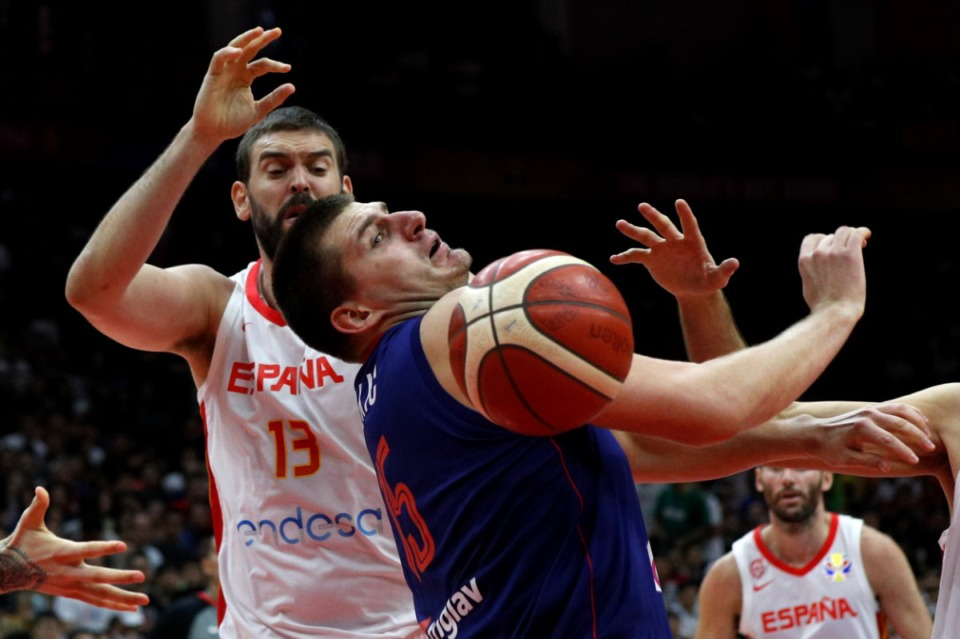 Nikola Jovic of Serbia misses his shot after tackling by Marc Gasol of Spain during their Group J second phase match against Serbia for the FIBA Basketball World Cup, at the Wuhan Sports Center in Wuhan in central China's Hubei province, Sunday, Sept. 8, 2019. (<strong>AP Photo/Andy Wong</strong>)