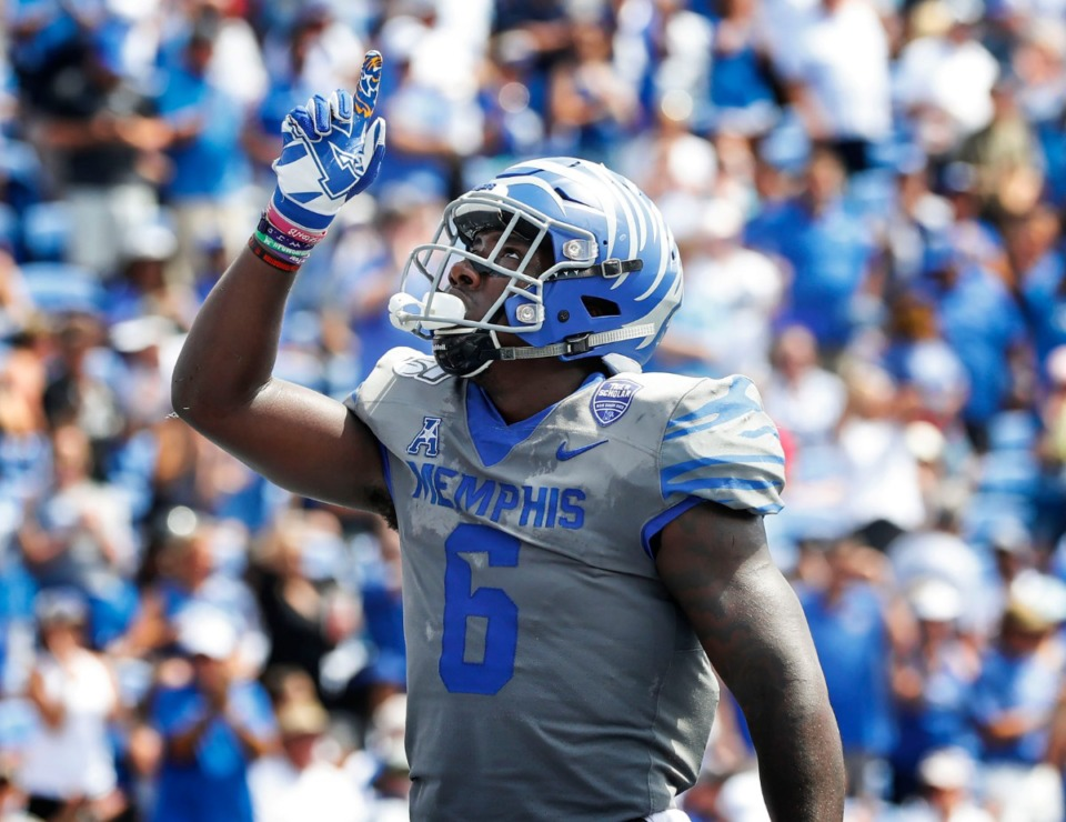 <strong>Memphis running back Patrick Taylor Jr. celebrates a touchdown against the Ole Miss defense during action in their NCAA football game at the Liberty Bowl Memorial Stadium Aug. 31, 2019.</strong> (Mark Weber/Daily Memphian)