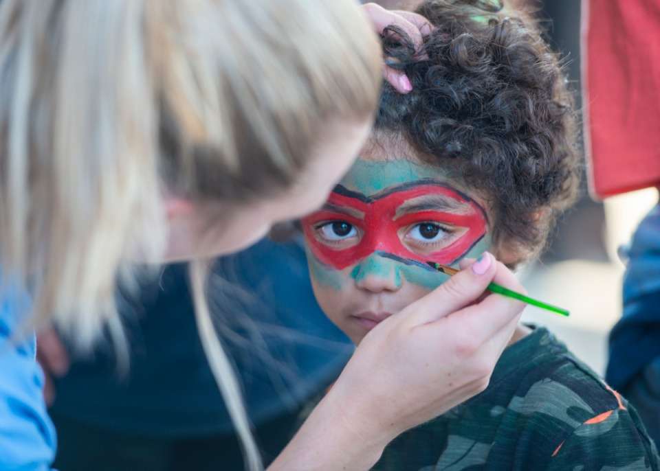 "<strong>Keshawn White gets his face painted by volunteer Lexi Williams at the ""Y on the Fly"" event with the YMCA and UnitedHealthcare at Millington Elementary School, Monday, Sept. 9.</strong> (Greg Campbell/Special to The Daily Memphian)"