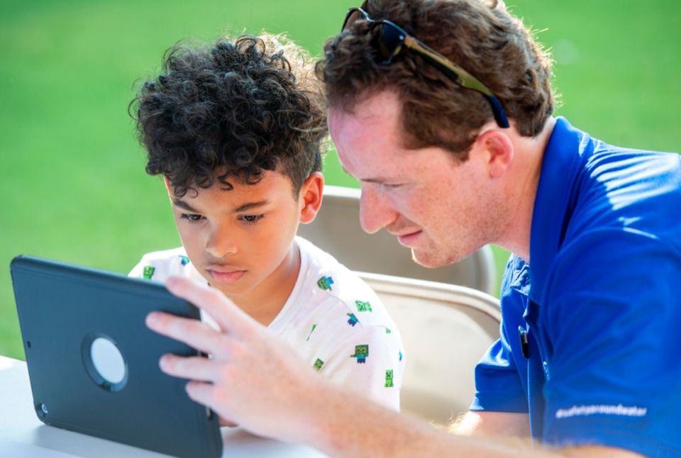 "<strong>Fourth grader Carlos Robles learns how to do stop-animation with the help of YMCA's Gabriel Katz at the ""Y on the Fly"" event at Millington Elementary School, Monday, Sept. 9.</strong> (Greg Campbell/Special to The Daily Memphian)"