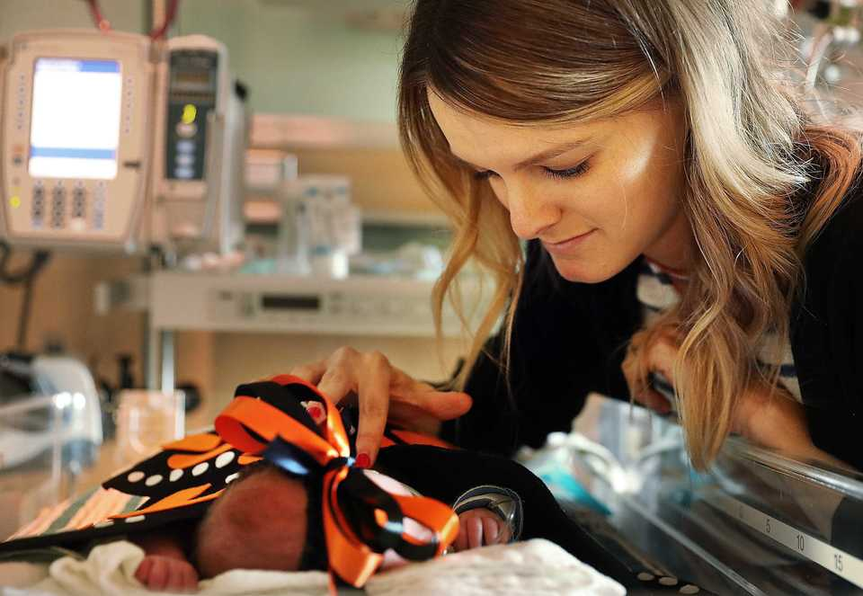 """<strong>Kaitlyn Bothwell's daughter, Kennedy, who was born six weeks premature, will spend her first Halloween in the neonatal intensive care unit (NICU) in the Women's &amp; Children's Pavilion at Methodist Le Bonheur Germantown Hospital. Bothwell said Kennedy's monarch butterfly is a fitting costume. """"She's growing into a beautiful butterfly.""""</strong> (Patrick Lantrip/Daily Memphian)"""