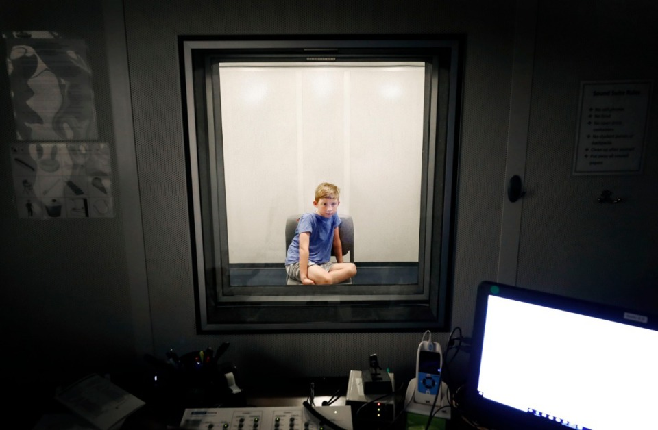 <strong>Charlie Wall, 8, takes part in a hearing test at the University of Memphis Speech and Hearing Clinic, Wednesday, July 17, 2019. Doctors&nbsp; at the U of M are conducting research to help kids who can hear, but whose brains can't process what their ears collect.</strong> (Mark Weber/Daily Memphian).