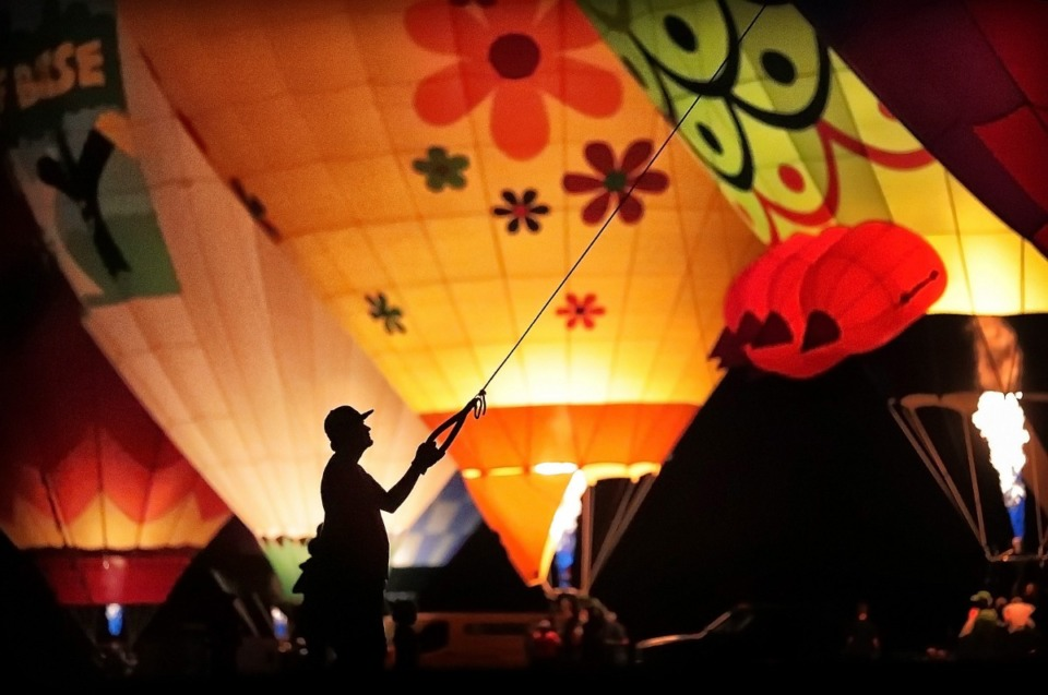<strong>A team member helps keep a hot air balloon tethered to the ground during the Spirit of Boise Balloon Classic nighttime glow show on Aug. 30, 2019, in Morrison Park in Boise, Idaho. A&nbsp; balloon glow is also among the events planned for the Great Bluff City Balloon Jamboree that is set for next June in Collierville.</strong> (Jim Weber/Daily Memphian)