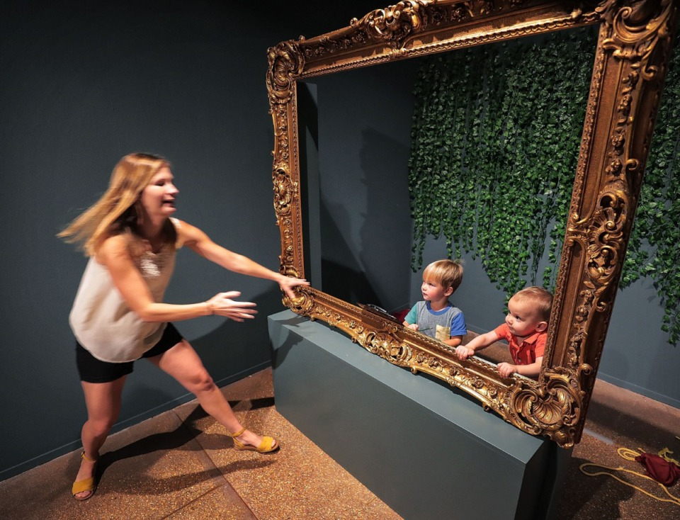 <strong>Mary Atwood (left) quick-steps to give a helping hand to one-year-old Harrison Parks (right) as he and Eliot Atwood (2) take part in the interactive portion of the Brooks Museum's exhibit of work by French academic painter William-Adolphe Bouguereau on Sept. 11, 2019. The Bouguereau exhibit is one of two important art shows that are winding down their runs here in Memphis.</strong> (Jim Weber/Daily Memphian)