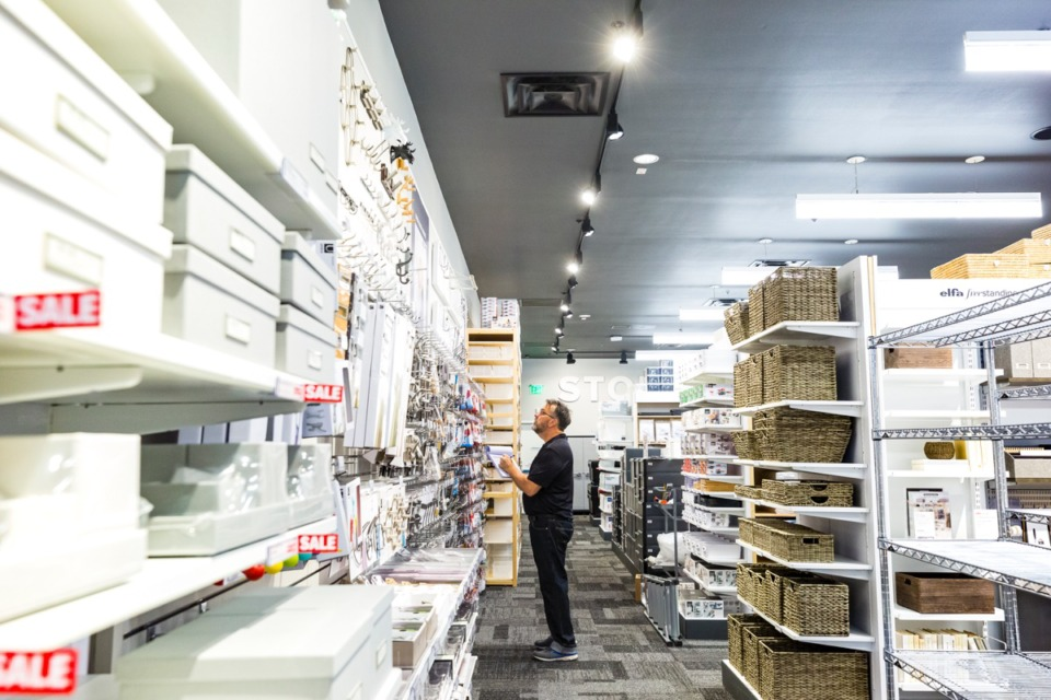 <strong>Bobby Campbell checks inventory inside the new Container Store in Germantown on Sept. 11. The store is set to open Saturday, Sept. 14.</strong> (Ziggy Mack/Daily Memphian)&nbsp;