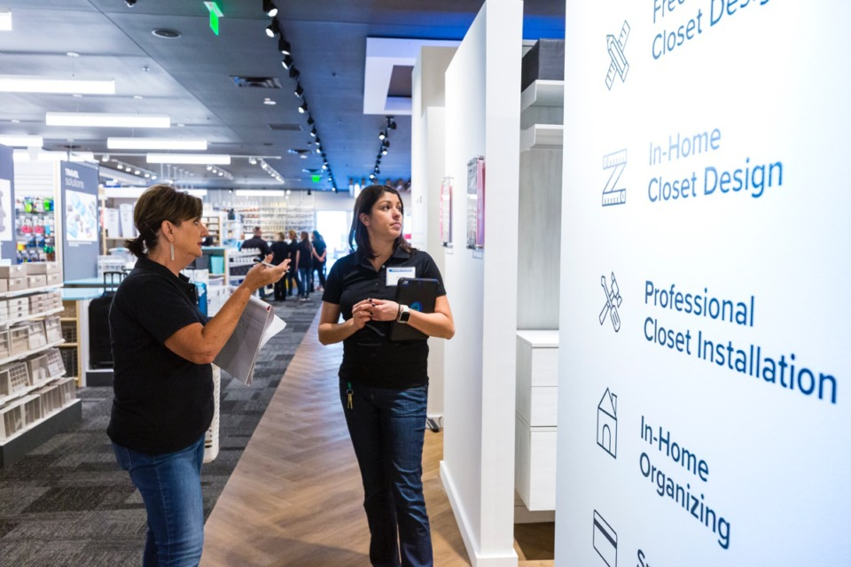 <strong>Allison Minchew and Jess Cruz discuss interior installation setups in front of a training group Sept. 11 inside the new Container Store in Germantown.</strong> (Ziggy Mack/Daily Memphian)