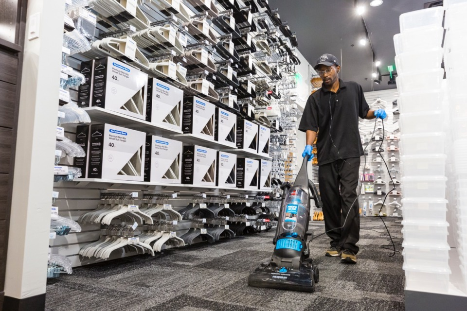 <strong>Don Green vacuums the floors inside Germantown's new Container Store in preparation for the Sept. 14 opening.</strong> (Ziggy Mack/Daily Memphian)