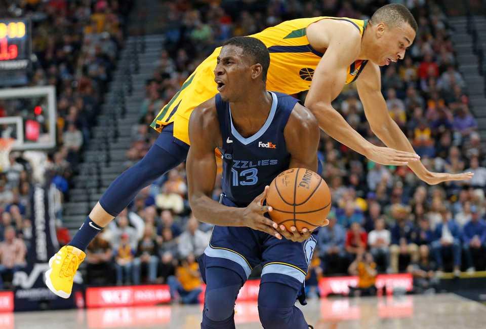 <span>Utah Jazz guard Dante Exum, right, fouls Memphis Grizzlies forward Jaren Jackson Jr. (13) in the first half during an NBA basketball game Monday, Oct. 22, 2018, in Salt Lake City. (AP Photo/Rick Bowmer)</span>