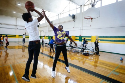 <strong>Chris Said, 15 (left), and Isiah Palm, 17 (right), play a pickup basketball game Sept. 11 during a dedication ceremony for the new community gym at MLK College Prep High School in Frayser.</strong> (Mark Weber/Daily Memphian)
