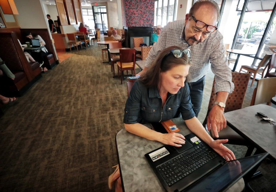 <strong>Realtor Thomas Marchbanks (right) with eXp Realty works with marketing director Allison Ogilvie at Panera Bread in Laurelwood Shopping Center on Sept. 10, 2019. Marchbanks is leading the Memphis office of a new kind of real estate agency which has no brick-and-mortar office, and operates from an internet based platform.</strong> (Jim Weber/Daily Memphian)