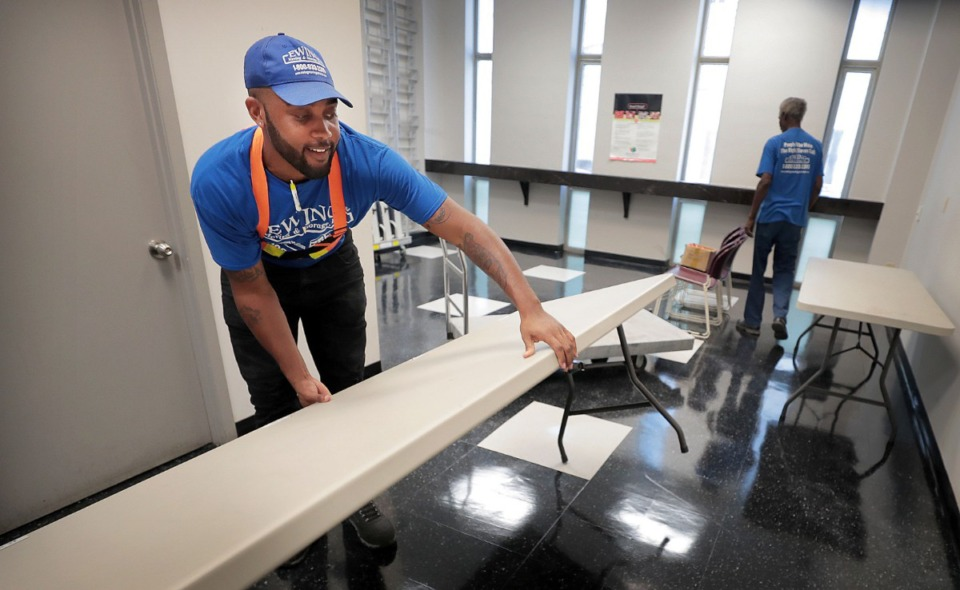 <strong>Marquise Harris and Henry Hancock (right) set up tables for election officials at the James Meredith Building in Downtown Memphis on Sept. 11.</strong> (Jim Weber/Daily Memphian)