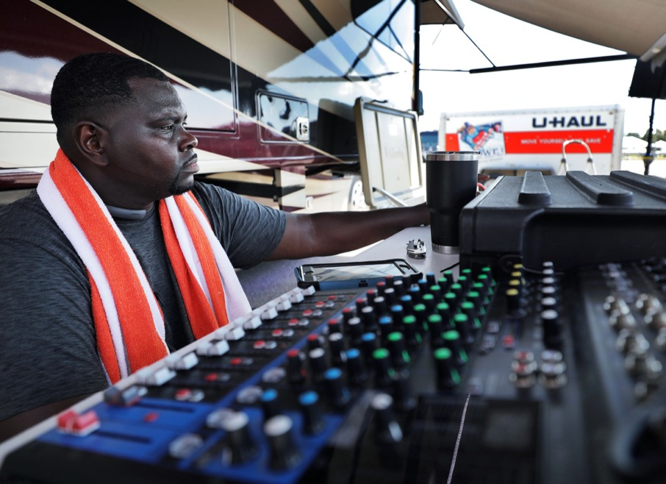 <strong>Jabbarsco Holloway, a Jackson State University alum, sets up his sound system outside of the Liberty Bowl Thursday, Sept. 12, in preparation of this weekend's Southern Heritage Classic festivities.</strong> (Patrick Lantrip/Daily Memphian)