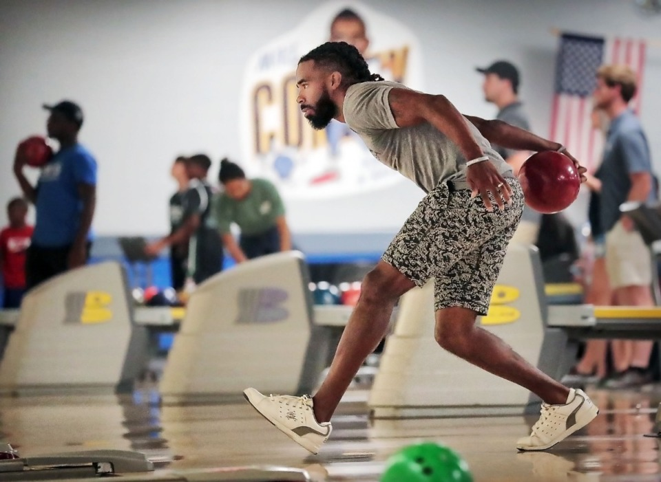 <strong>Former Grizzlies point guard Mike Conley bowls few frames during his annual Bowl-n-Bash charity event at Billy Hardwick All-Star Lanes on Sept. 14, 2019, to raise money for the Methodist Comprehensive Sickle Cell Center.</strong> (Jim Weber/Daily Memphian)