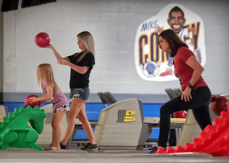 <strong>Bowlers young and old participate in former Grizzlies point guard Mike Conley's annual Bowl-n-Bash charity event at Billy Hardwick All-Star Lanes on Sept. 14, 2019, to raise money for the Methodist Comprehensive Sickle Cell Center.</strong> (Jim Weber/Daily Memphian)