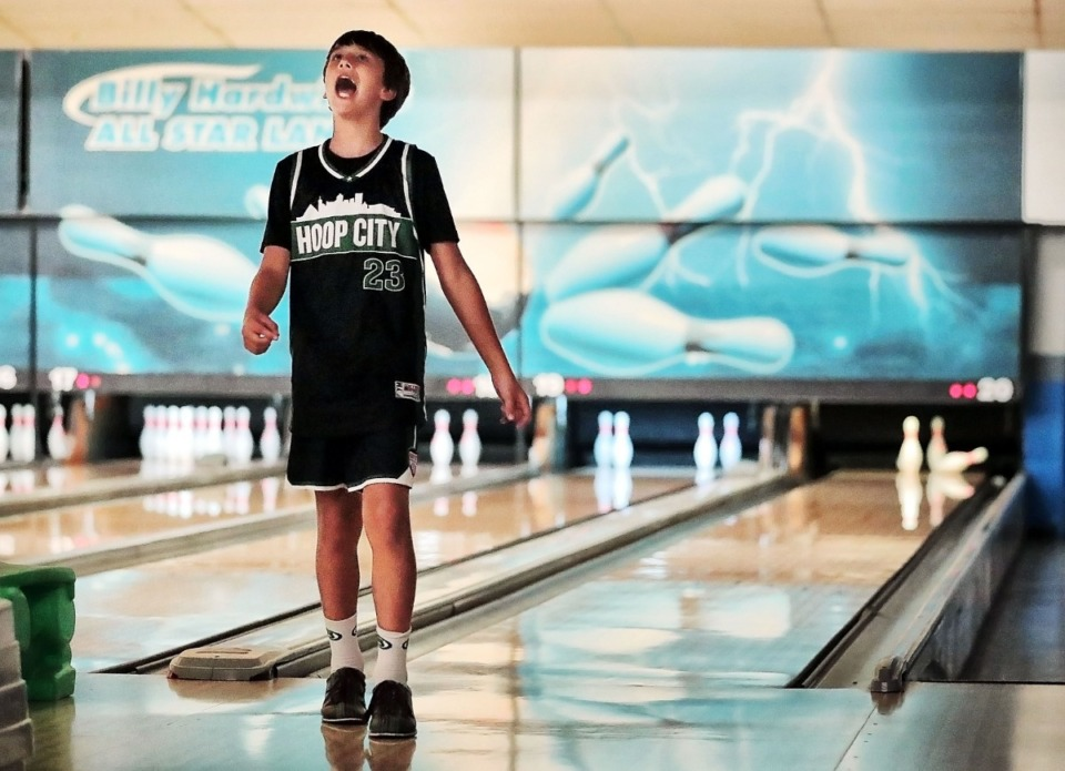 <strong>Parker Pounds, 11, reacts to a missed spare during former Grizzlies point guard Mike Conley's annual Bowl-n-Bash charity event at Billy Hardwick All-Star Lanes on Sept. 14, 2019, to raise money for the Methodist Comprehensive Sickle Cell Center.</strong> (Jim Weber/Daily Memphian)