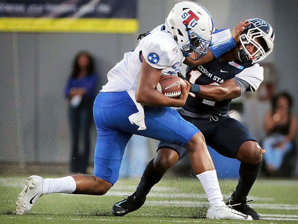 <strong>Tennessee State quarterback Octavious Battle (8) shoves aside a Jackson State University defender during the first quarter of the 30th annual Southern Heritage Classic at Liberty Bowl Memorial Stadium on Saturday, Sept. 14, 2019.</strong> (Patrick Lantrip/Daily Memphian)