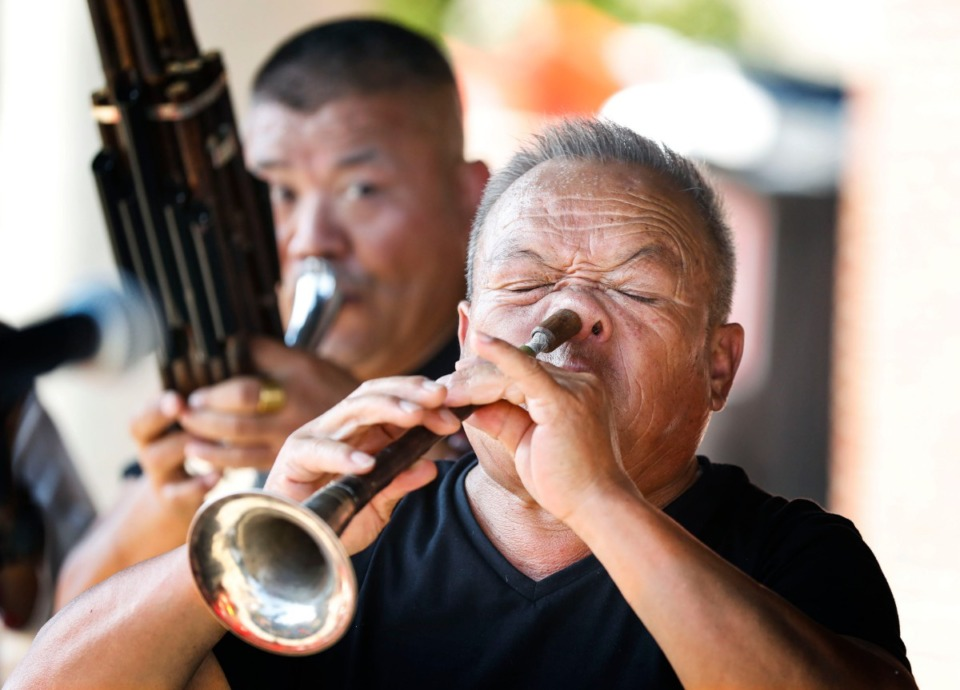 <strong>Zhou Ben Xiang uses his nose while performing with a suona horn during the Memphis Chinese History and Culture Festival in Handy Park Sunday, Sept. 15, 2019.</strong> (Mark Weber/Daily Memphian)