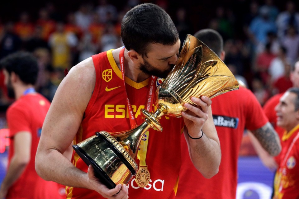 <strong>Marc Gasol of Spain celebrates with the Naismith Trophy after they beat Argentina in their first-place match in the FIBA Basketball World Cup at the Cadillac Arena in Beijing, Sunday, Sept. 15, 2019.</strong> (Mark Schiefelbein/Associated Press)