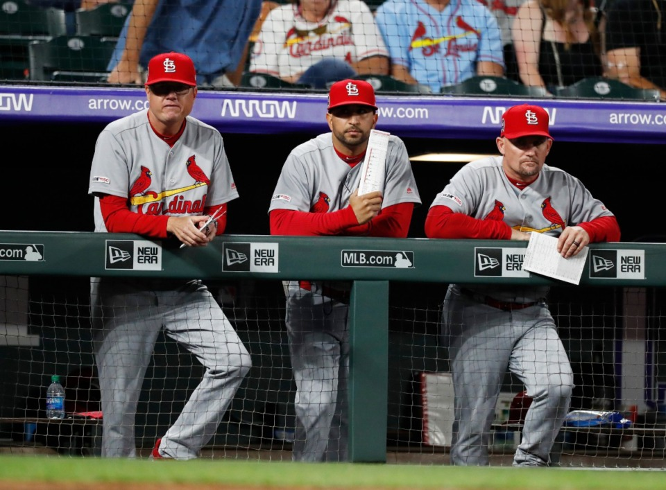 <strong>St. Louis Cardinals first base coach Stubby Clapp (right, with manager Mike Shildt, left, and bench coach Oliver Marmol) watch from the dugout as the team plays the Colorado Rockies on Sept. 11, in Denver. The former manager of the Memphis Redbirds</strong><span><strong>&nbsp;is in the middle of a red-hot MLB pennant race.</strong>&nbsp;</span>(David Zalubowski/Associated Press)