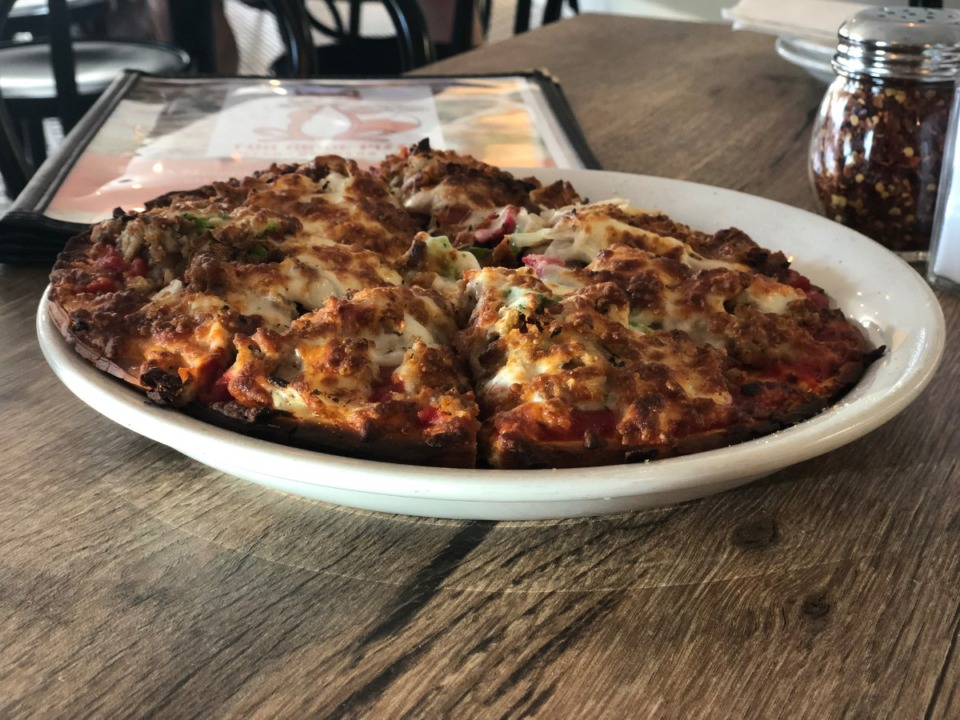 <strong>A lot of cheese and toppings makes for a Memphis-style pizza at Fox Ridge Pizza &amp; Grill.</strong> (Jennifer Biggs/Daily Memphian)