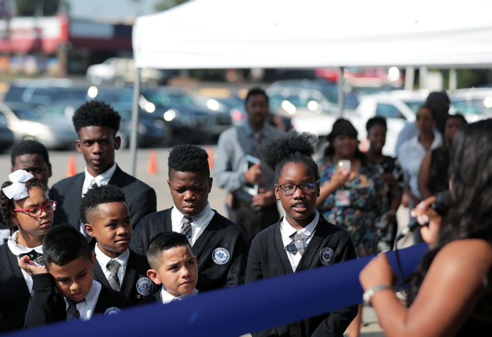 <strong>Rahnyiah Washington (far right) and her Power Center Academy Elementary School classmates listen as state Sen. Katrina Robinson addresses the crowd at the school's Hickory Hill campus Tuesday, Sept. 17.&nbsp;&ldquo;Hickory Hill has experienced its challenges, but Power Center Academy has been a mainstay in Hickory Hill,&rdquo; said Robinson, a &ldquo;founding parent&rdquo; at the school. &ldquo;Power Center is now going to be the nucleus of Hickory Hill.&rdquo;</strong>&nbsp;(Patrick Lantrip/Daily Memphian)