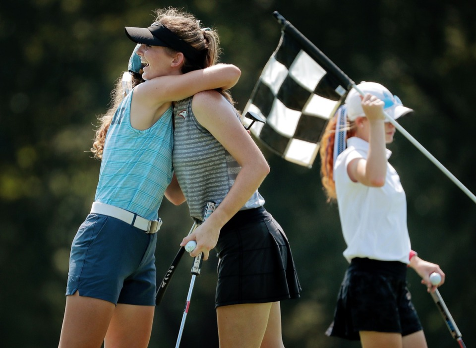 <strong>Margaret Porter from ECS (center) embraces Rachel Heck from St. Agnes (left) after finishing their round at the Division 2 girls region golf tournament at Windyke Sept. 19.</strong> (Jim Weber/Daily Memphian)